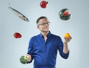 Dr. Michael Mosley showing juggling with foods