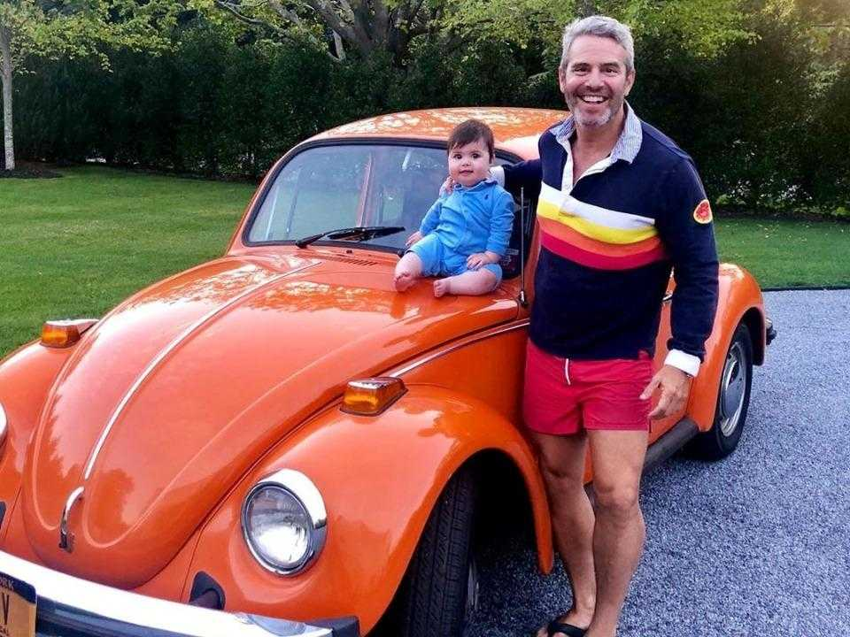 Andy Cohen posing with the car.