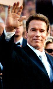Arnold Waving at Audience