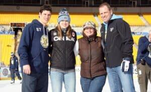 Sidney alongside his family members.