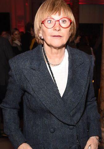 Anne Robinson in black coat.