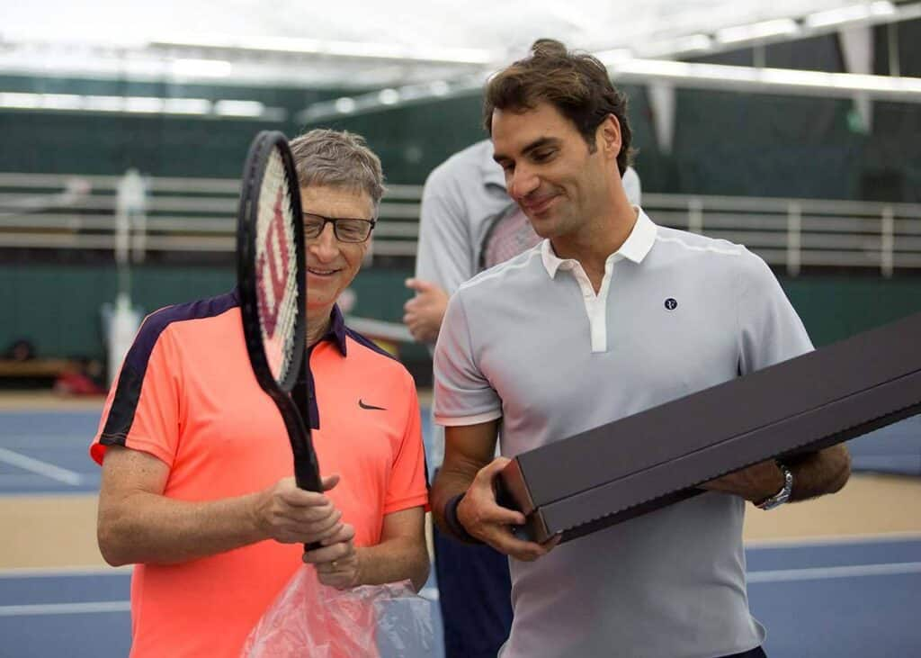 Bill Gates with Roger Federer in a charity tennis match