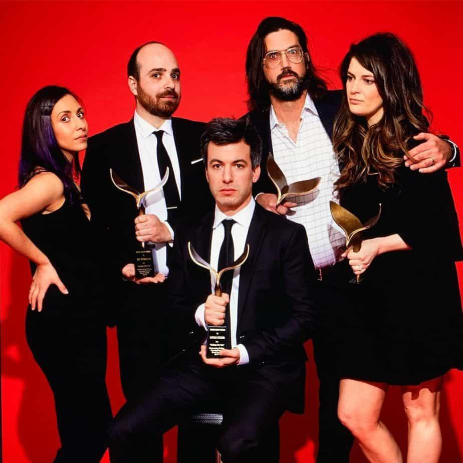 Nathan Fielder holding WGA Award with his team.