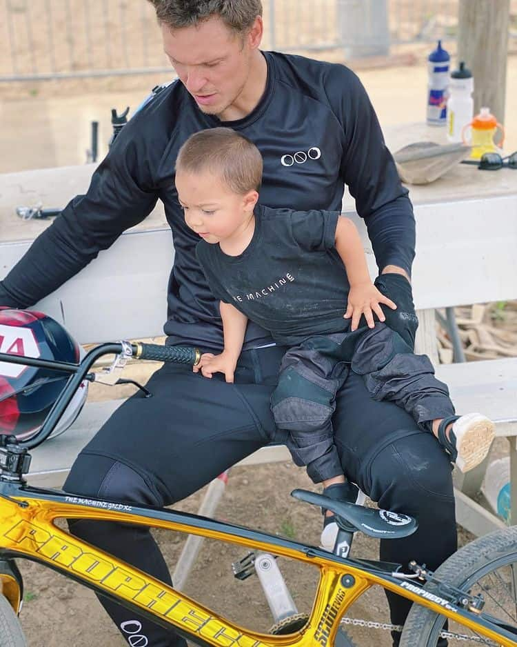 Maris with his son Rio looking at a bike