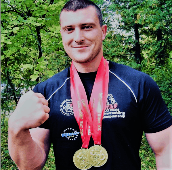 Andrew with medals and a T-shirt from the World Cup in Italy, 2009