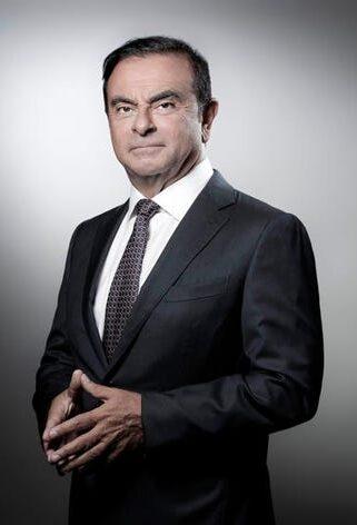 Carlos Ghosn is Posing in a Suit.