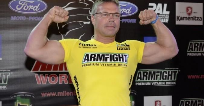 John Brzenk flexing his muscles