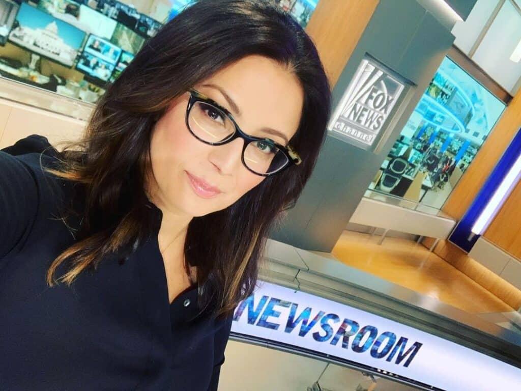 Julie Banderas working for CNN.