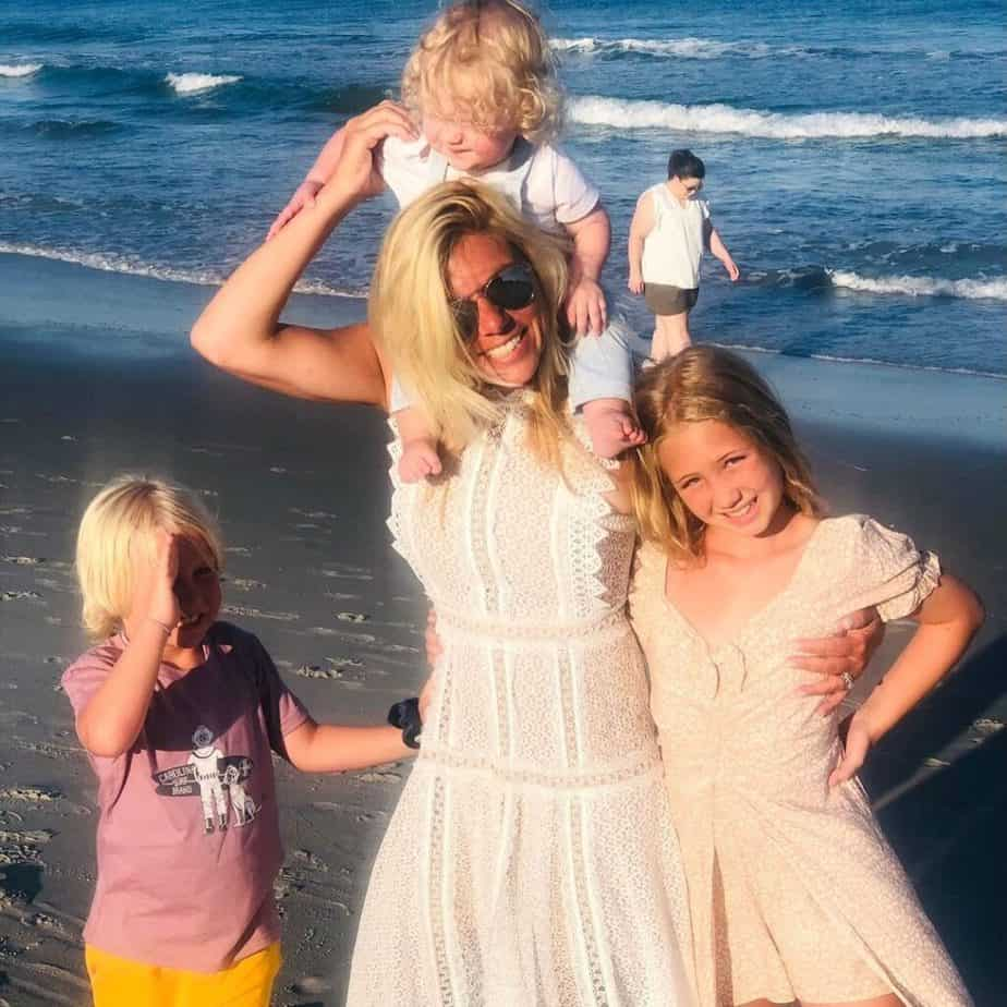 Molly Grantham with her kids in a beach.
