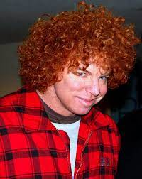 Carrot Top is Smiling at Camera.