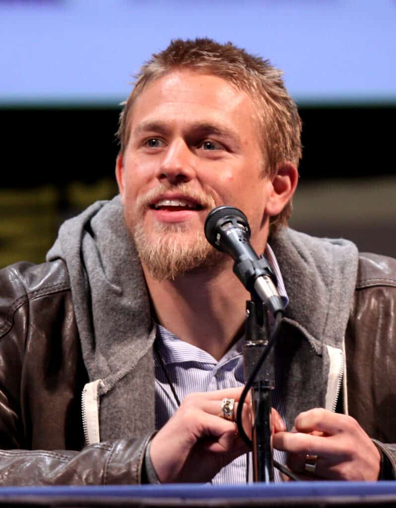 Charlie Hunnam talking with people.