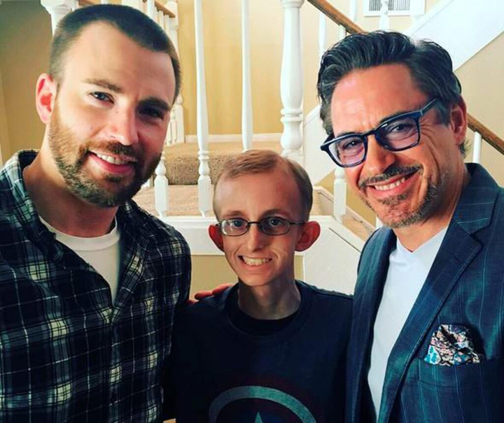 Chris Evans and Robert Downey Jr. with a fan.