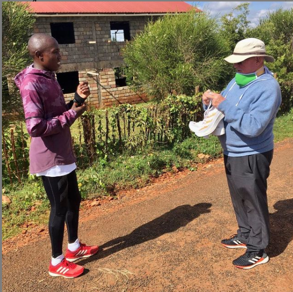 Rhonex Kipruto with his coach Brother Colm O'Collenner.