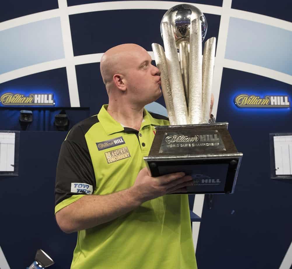 MIchael Van Gerwen with the World Darts Championship trophy