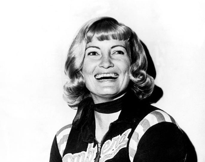 Joan Weston smiling for a camera