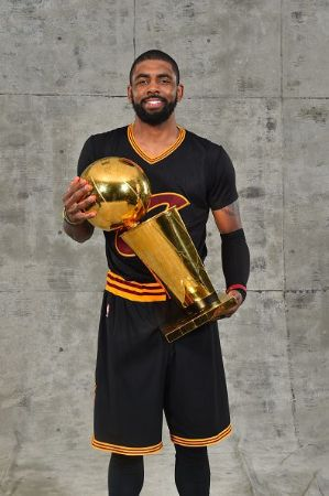 Irving holding the trophy