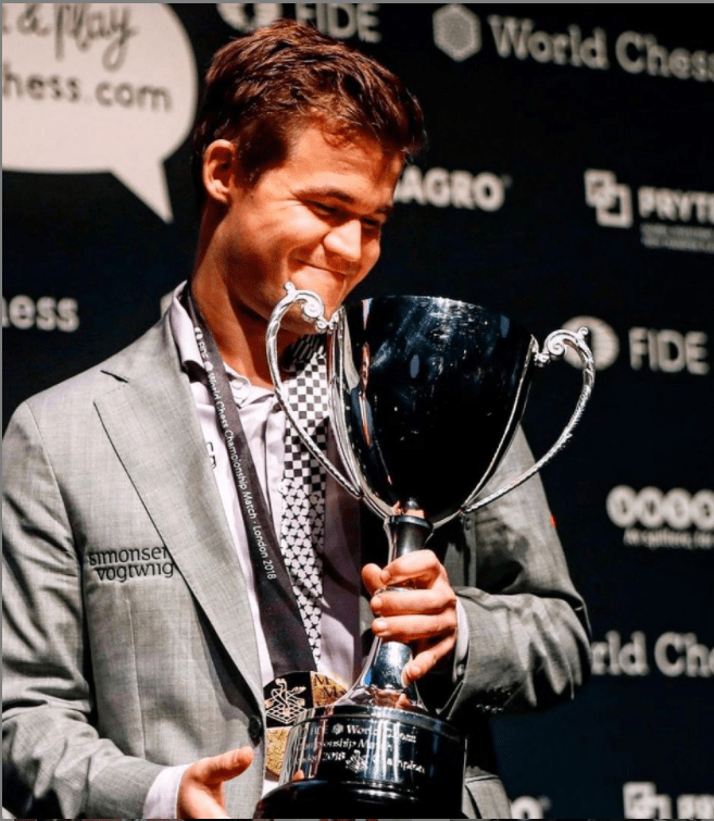 Carlsen with the World Chess Championship trophy