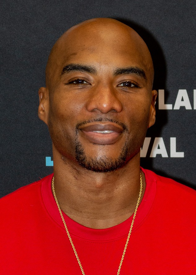 Charlamagne with a cheerful face.