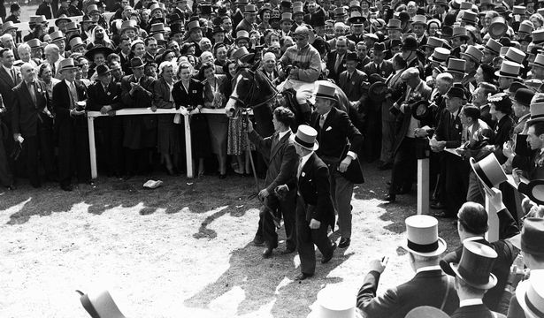 Pinza and Sir Gordon Richards enter the winner's enclosure after success in the 1953 Epsom Derby.